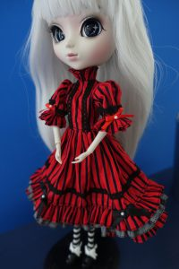 Optical Alice in her red dress without her apron.