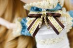 Detail of the big bow attached to the blue dress.