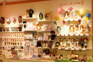 The wall with all of the dolly clothes!